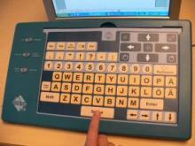 Programmerbart tangentbordsunderlag med tangenter och mysfunktioner.