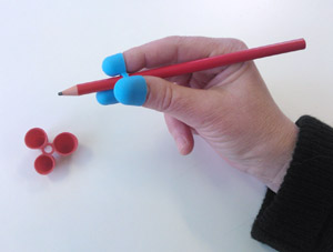 En penna med stöd som underlättar greppet.
