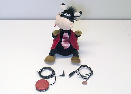 patterikäyttöinen lelu, lelukaapeli ja painikekytkin